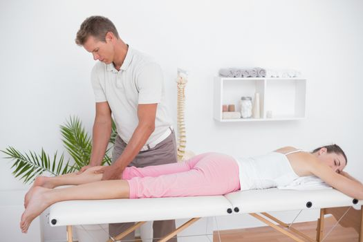 Physiotherapist doing calf massage