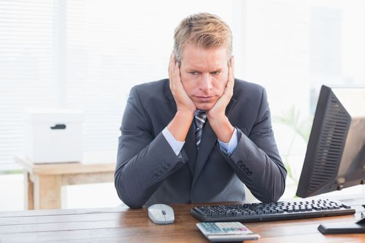 Depressed businessman at his desk