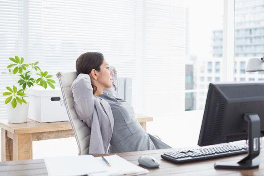 Businesswoman relaxing in a swivel chair