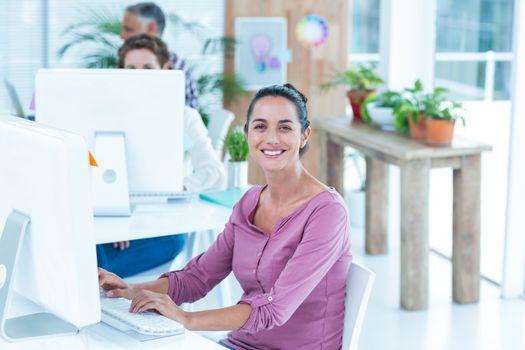 Portrait of businesswoman using computer
