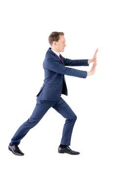 A businessman pushing something