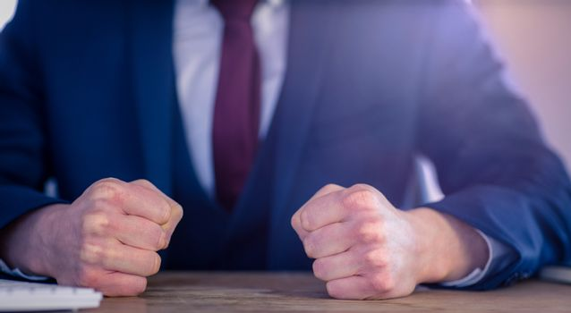 Angry businessman with closed fists