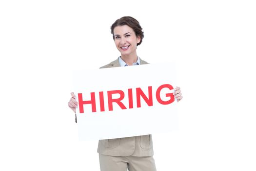 Businesswoman holding a hiring sign
