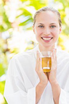 Attractive woman drinking tea