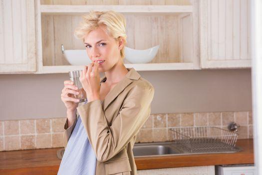 Blonde pregnancy taking a vitamin