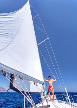 Cheerful man on sailboat