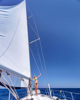 Happy woman on sailboat