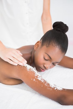 Pretty woman enjoying an exfoliation massage