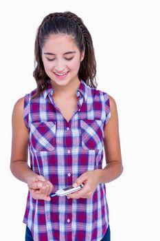 Diabetic brunette using blood glucose monitor