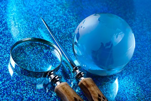 Glass globe, saturated worldwide concept