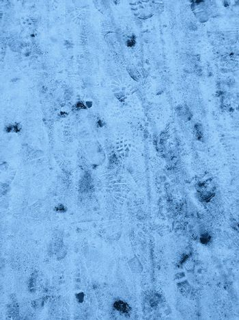 Natural snow texture with footprints