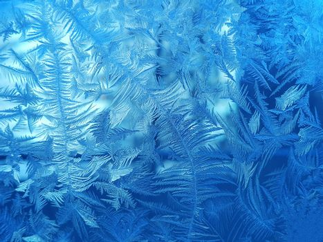Texture of beautiful ice pattern on winter glass