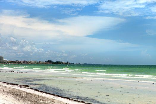 Siesta Key Beach is located on the gulf coast of Sarasota Florida with powdery sand.