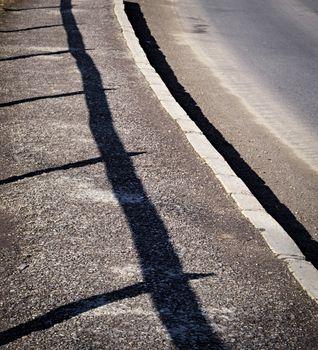 shadow railing on the sidewalk