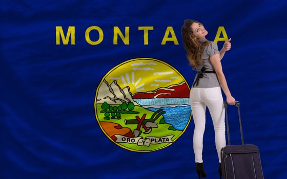 young beautiful woman is traveling to montana