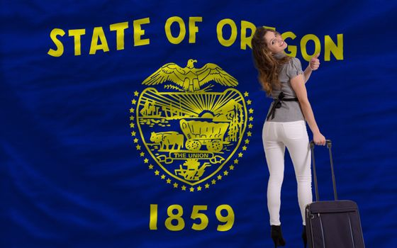 young beautiful woman is traveling to oregon