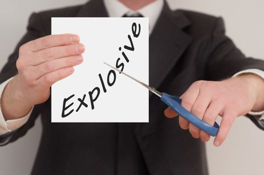 Explosive, man in suit cutting text on paper with scissors