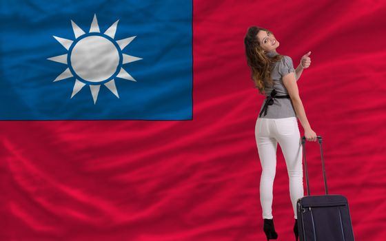 young beautiful woman is traveling to taiwan