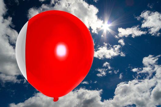 balloon in colors of bahrain balloon flag flying on blue sky