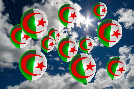 many ballons in colors of algeria flag flying on sky