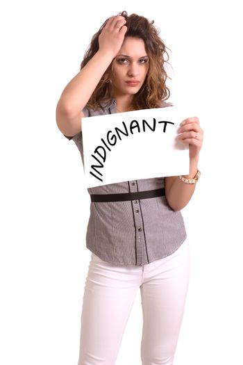 Young attractive woman holding paper with Indignant text on white background