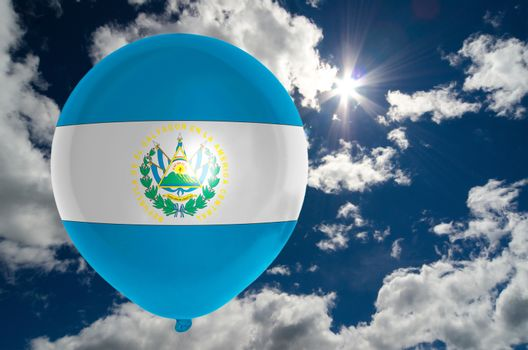 balloon in colors of el salvador flag flying on blue sky