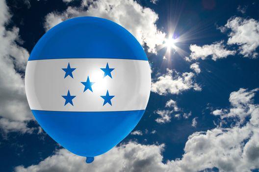 balloon in colors of honduras flag flying on blue sky