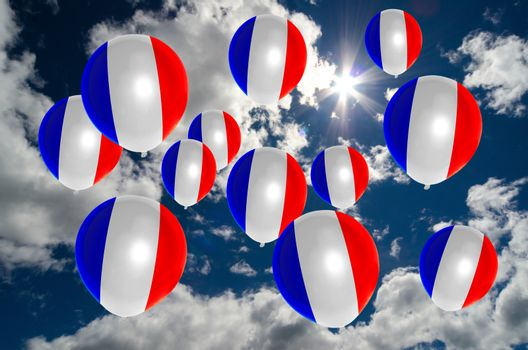 many ballons in colors of france flag flying on sky