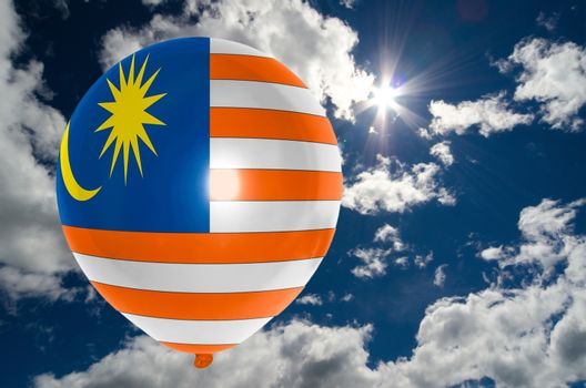 balloon in colors of malaysia flag flying on blue sky