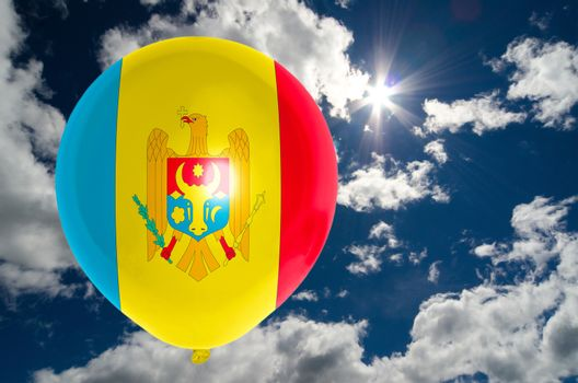 balloon in colors of moldova flag flying on blue sky