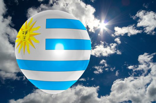 balloon in colors of uruguay flag flying on blue sky