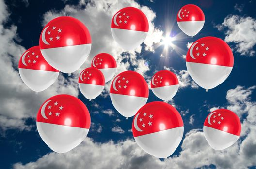 many ballons in colors of singapore flag flying on sky