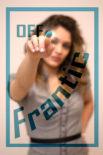 young woman turning off Frantic on screen