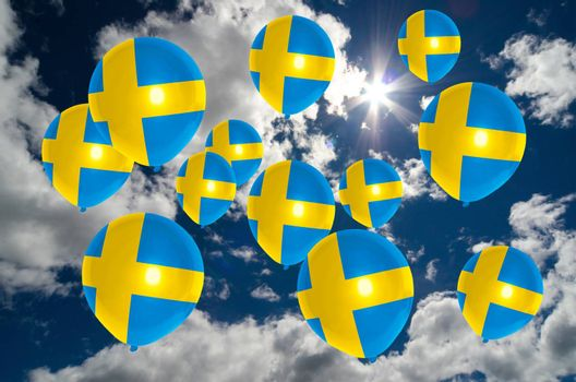 many ballons in colors of sweden flag flying on sky