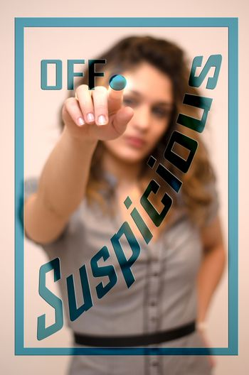 young woman turning off Suspicious on screen