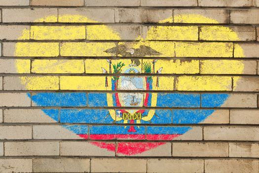 heart shaped flag in colors of ecuador on brick wall