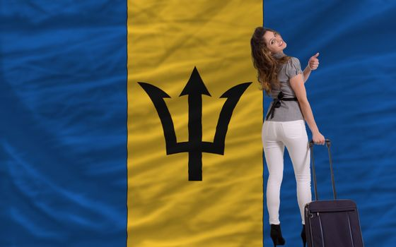 young beautiful woman is traveling to barbados