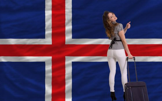 young beautiful woman is traveling to iceland
