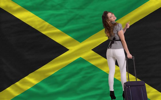 young beautiful woman is traveling to jamaica