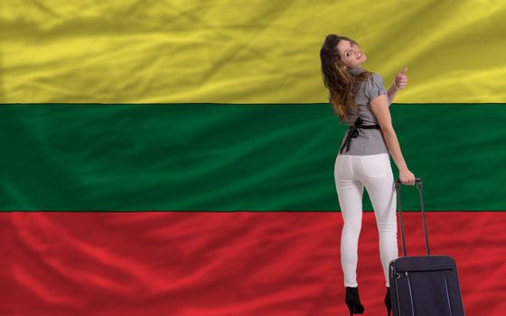 young beautiful woman is traveling to lithuania