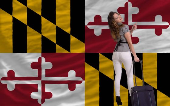 young beautiful woman is traveling to maryland