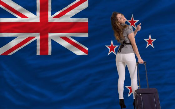 young beautiful woman is traveling to new zealand