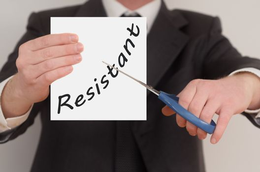 Resistant, man in suit cutting text on paper with scissors
