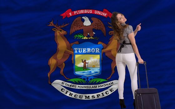 young beautiful woman is traveling to michigan