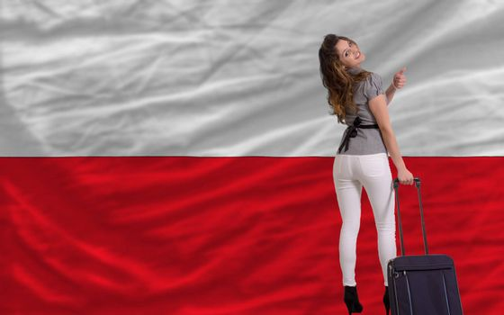 young beautiful woman is traveling to poland