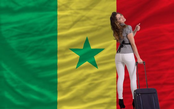 young beautiful woman is traveling to senegal
