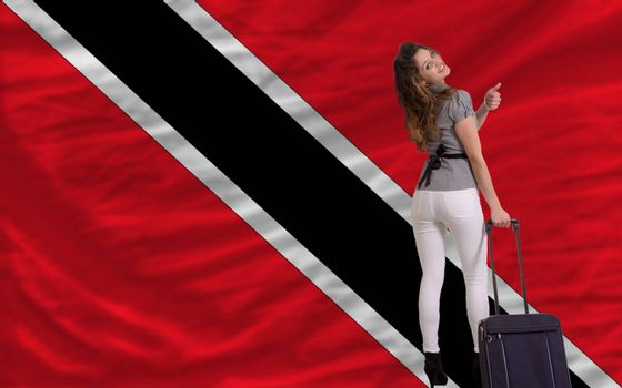 young beautiful woman is traveling to trinidad and tobago