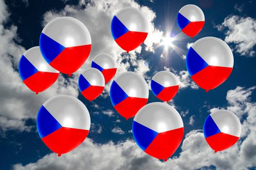 many ballons in colors of czech flag flying on sky