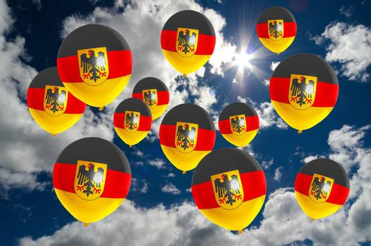 many ballons in colors of germany flag flying on sky