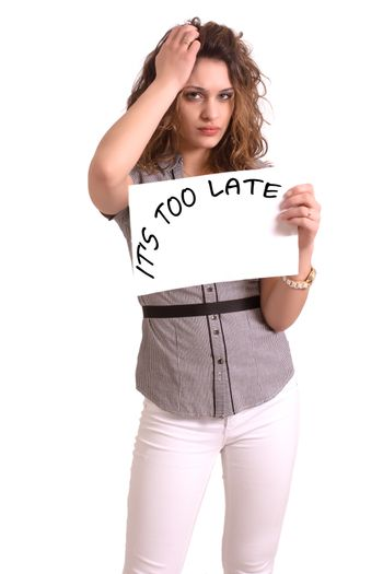 Young attractive woman holding paper with It's too late text on white background
